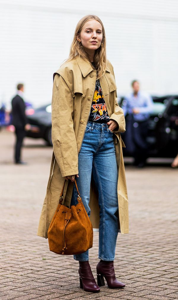 There's something effortlessly cool-looking about a trench coat and band tee worn together.