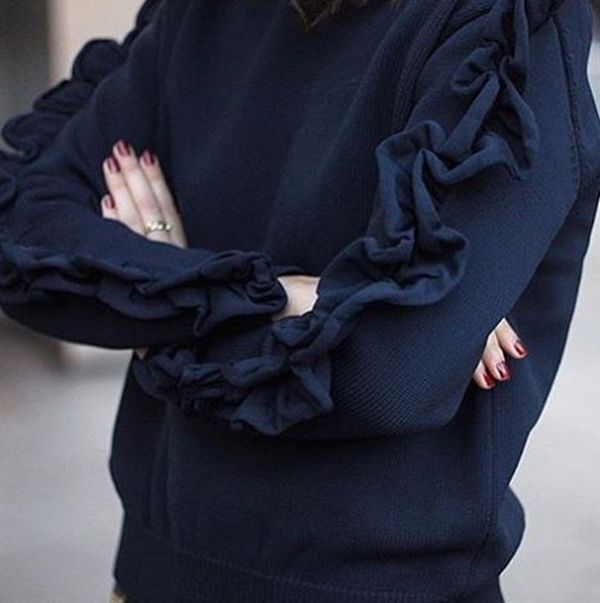 Navy blue sweater with blue ruffle sleeves