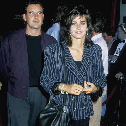Courteney Cox on the red carpet wearing oversized shoulders -- classic eighties fashion