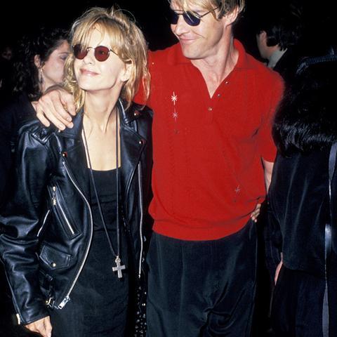 Meg Ryan wearing a leather jacket, slip dress, and big socks - the ultimate eighties fashion ensemble