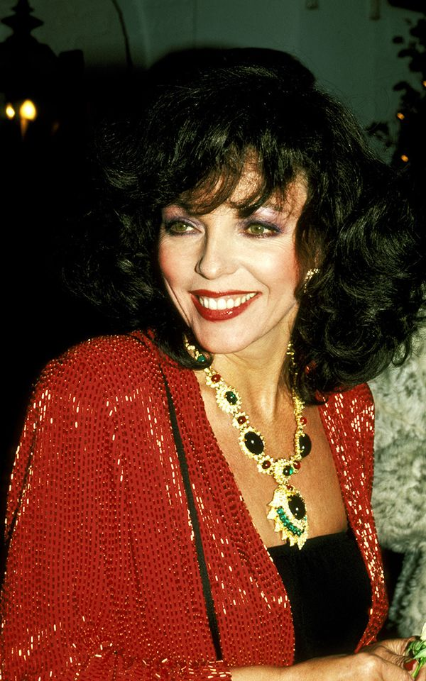 Joan Collins wears an oversized necklace which is part of eighties fashion