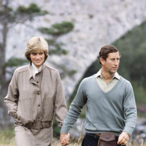 Princess Diana in a checked coat, with Prince Charles during the eighties