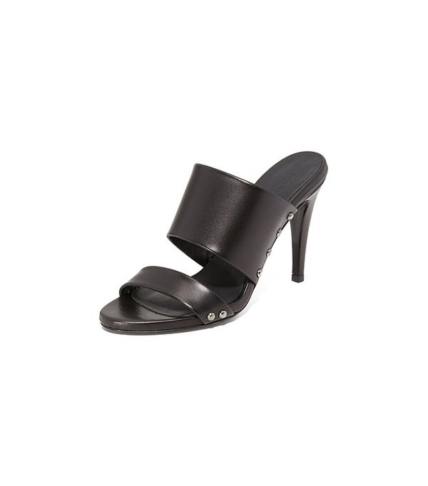 2. Pair sleek heels with an understated outfit.