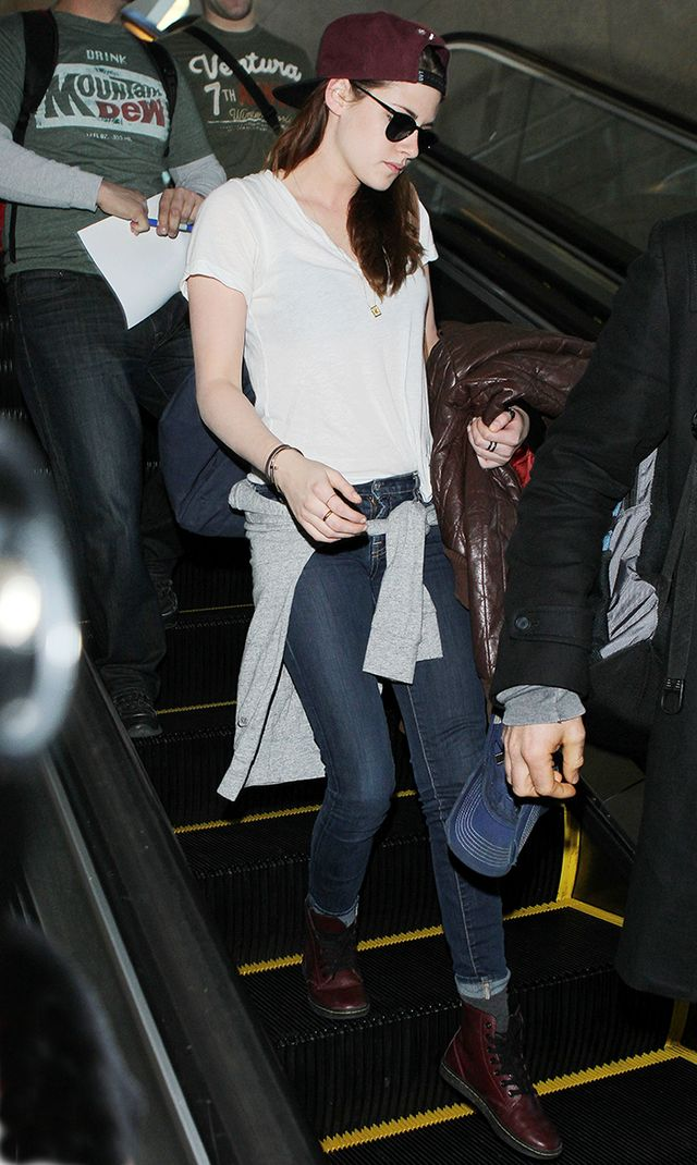 On Kristen: A.L.C. t-shirt; dark skinny jeans; Us Versus Them hat; Dr. Martens Leyton Leather Sneakers ($80) in Red.