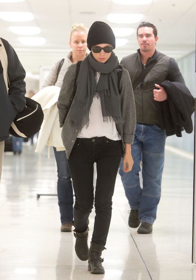 On Rooney: Black beanie; grey cardigan; Chan Luu scarf; black jeans; black boots.