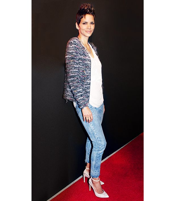 A feminine topper pulls together a simple untucked t-shirt and jeans.