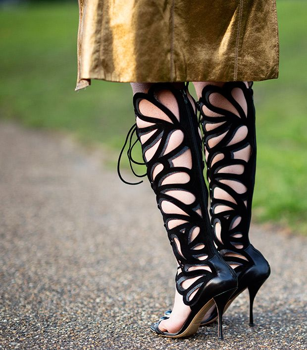Style note: Knee-high lattice sandals embrace the season's gladiator trend in a feminine way.