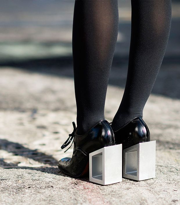 Style note: Black lace-ups and block heels are the perfect retro-modern hybrid.