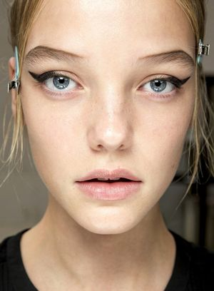Graphic Eyebrows And Winged Eyeliner At Prada S/S 2015
