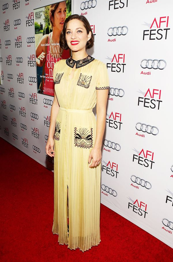 Style Notes: Similarly, Marion Cotillard does pastel yellow with aplomb thanks to her contrasting hair and bright red lip.