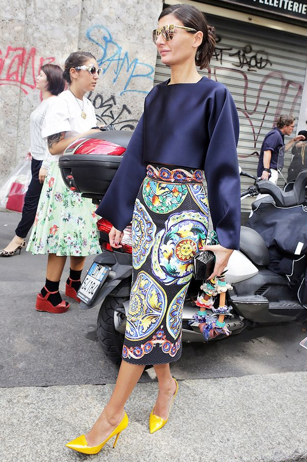 Style Notes: Giovanna Englebert looks incredible in a plain navy top paired with a patterned skirt.