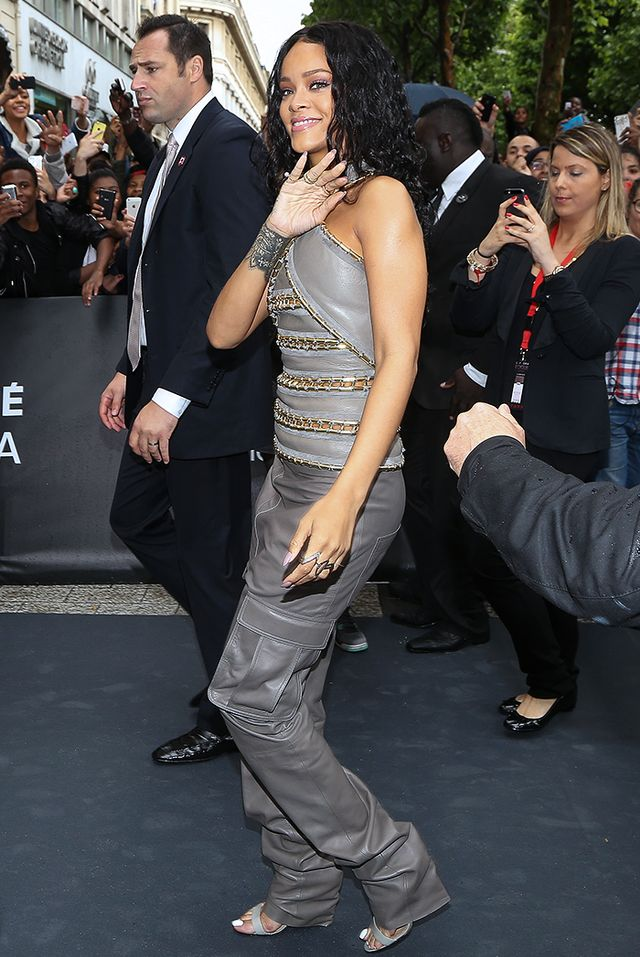 For her Rogue by Rihanna perfume launch in Paris this summer, she opted for another matching ensemble, this time wearing aBalmain F/W 14 leather top and cargo pants withManolo Blahnik...