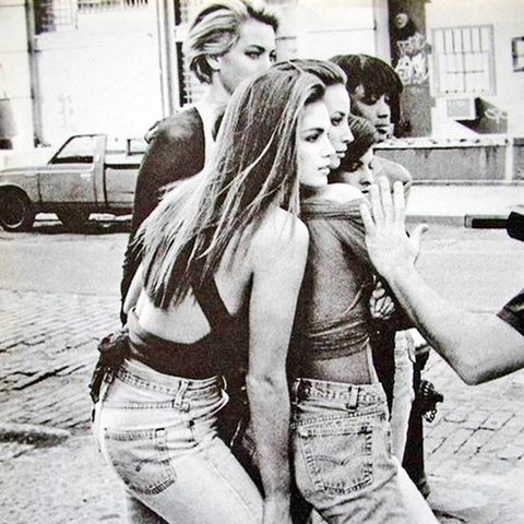 27. Pair a crop top with high-waisted vintage jeans.