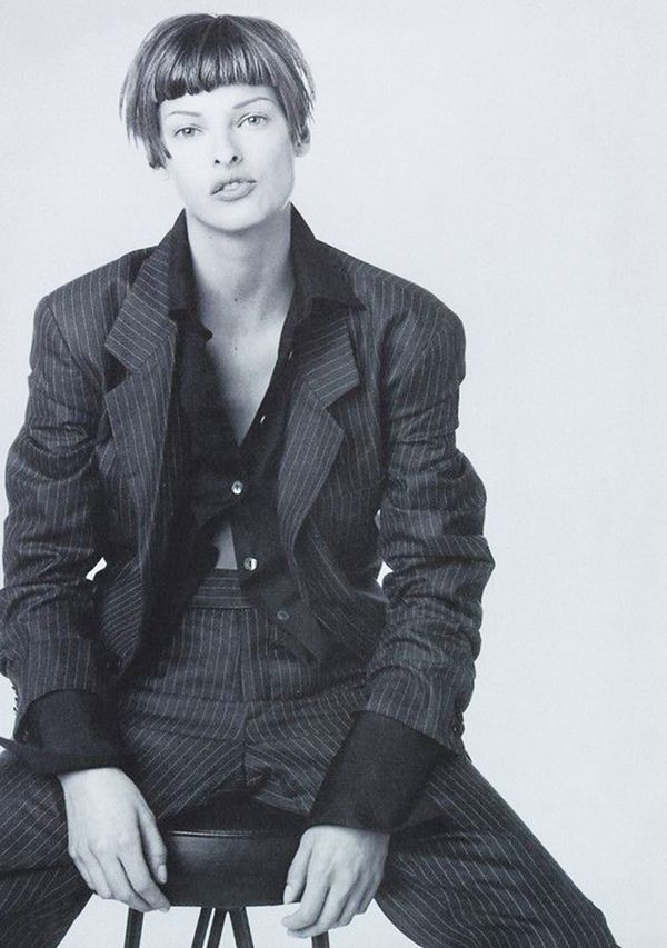 39. Leave your shirt buttoned only at the bust for an alluring look.