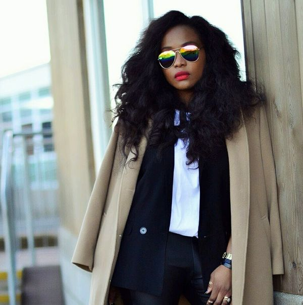 White blouse with black blazer and tailored camel coat