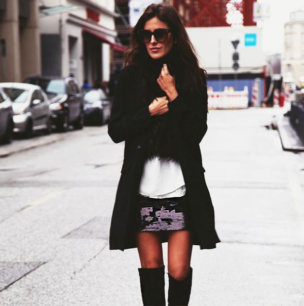 White blouse with mini skirt, knee-high boots, and black coat and scarf