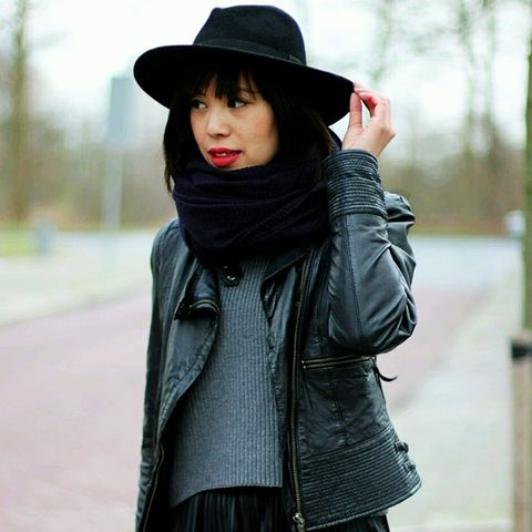 Gray sweater with leather jacket, chunky black scarf and black hat
