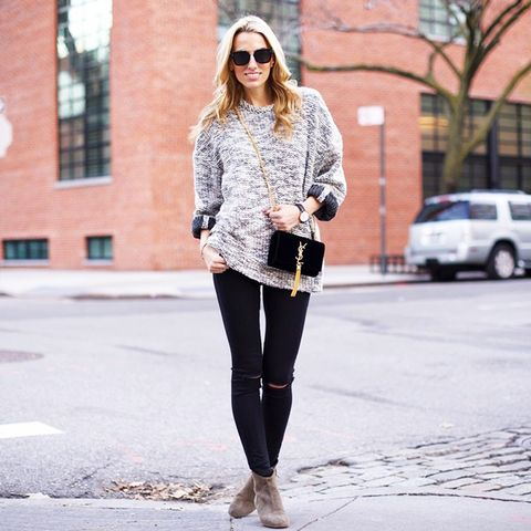 Neck detail sweater with ripped-knee black jeans and beige ankle boot