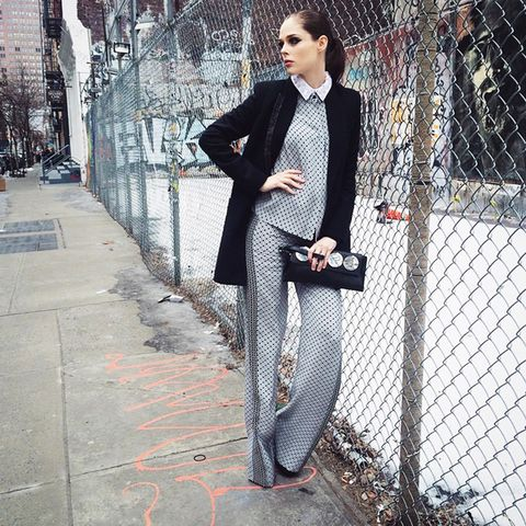 Co-ord collar top and wide-leg pants and black coat