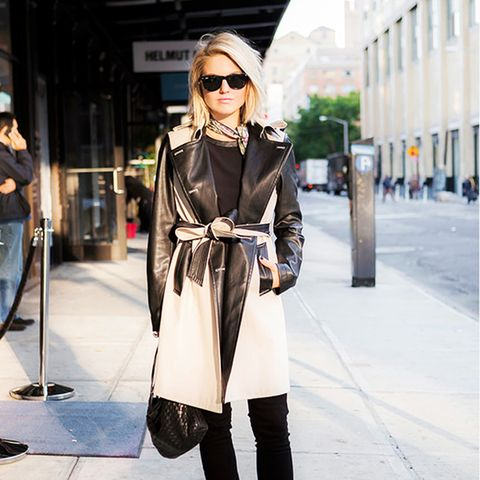 Two-tone leather trench and neck scarf with black top, pants, and pointed boots