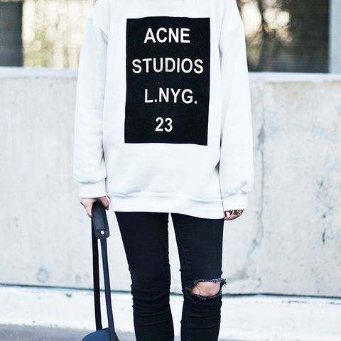 Acne studios sweatshirt with ripped-knee jeans