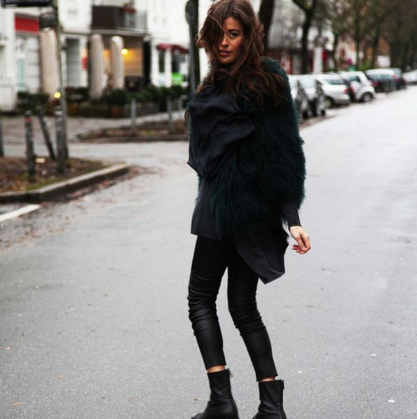 Fur coat with black leather pants and black ankle boots