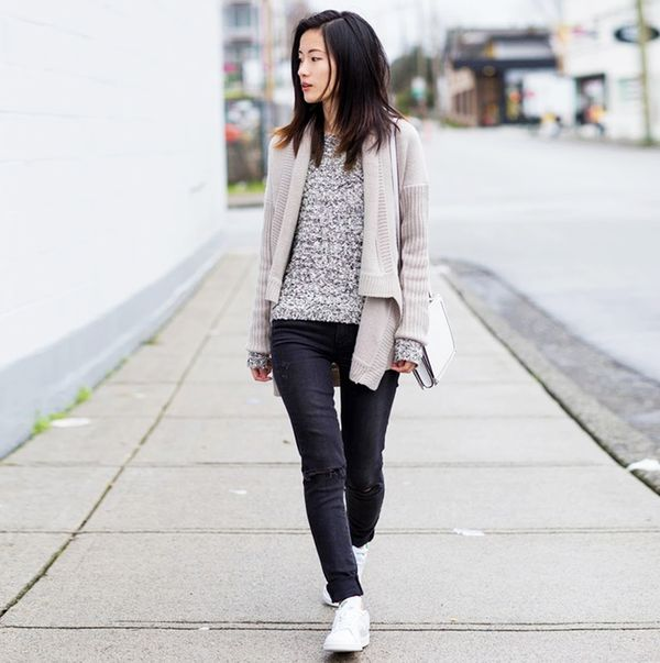 Tan sweater jacket with black denim jeans and Adidas sneakers