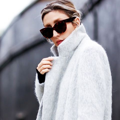 Grey coat with tortoise shell cat eye sunglasses