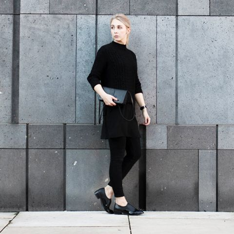 Black mock neck sweater with black legging and patent black loafers