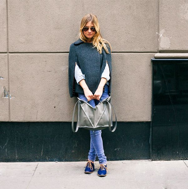 Teal cape with jeans, blue oxfords, and oversized tote