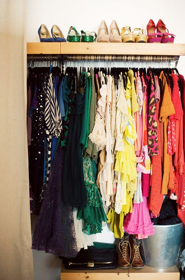 Color-coding your clothing makes navigating a packed closet infinitely easier. The hard part is keeping it color-coded, but the extra effort is worth it!