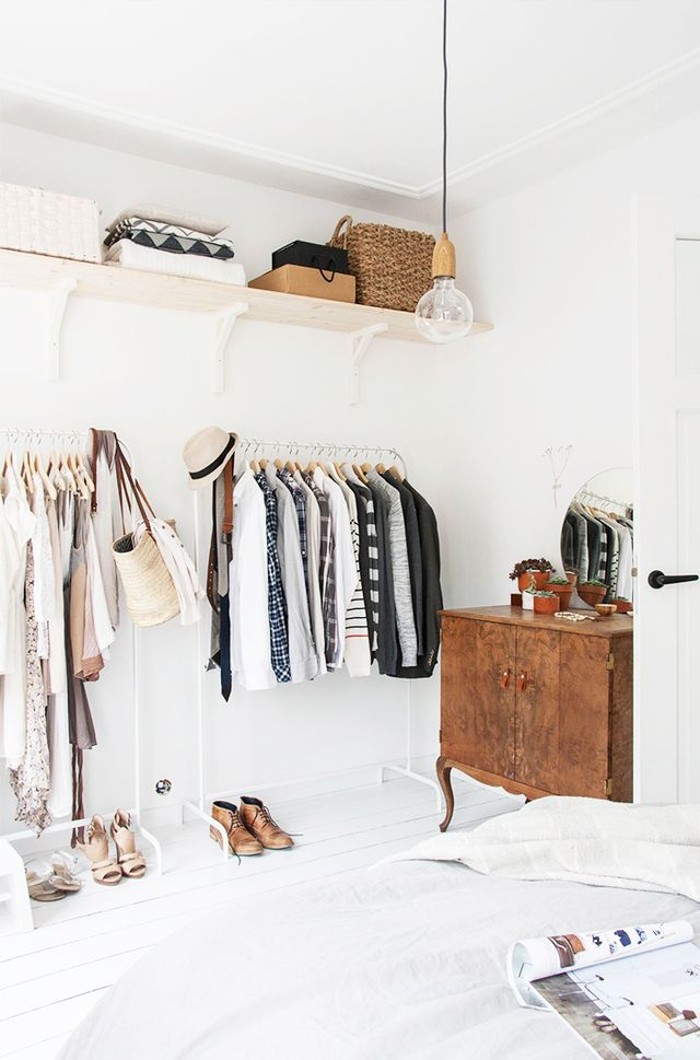 By grouping short clothing (such as tops and blazers) and long clothing (such as dresses and coats together), you'll free up a large expanse of space under your short items.