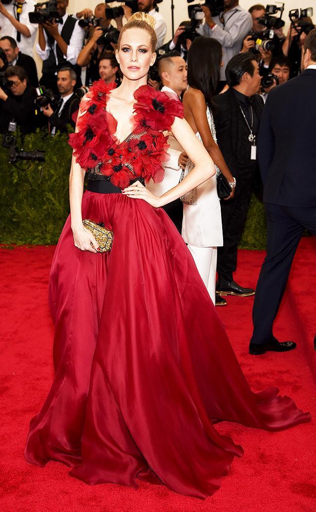 WHO: Poppy Delevingne WEAR: Marchesa silk poppy flower gown with full organza skirt and belt; Edie Parker clutch.