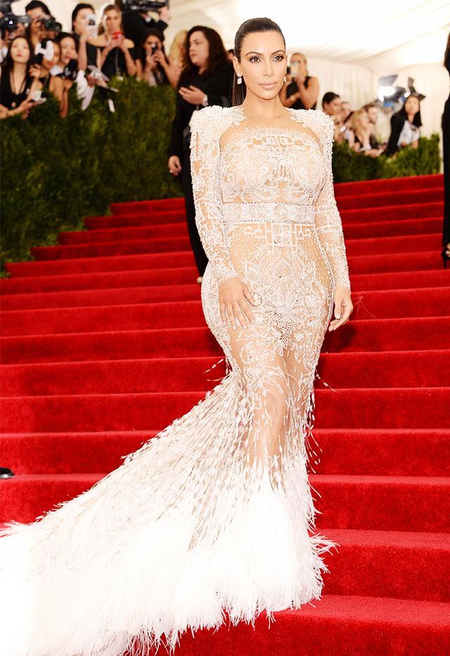WHO: Kim Kardashian WEAR: Roberto Cavalli by Peter Dundas gown.