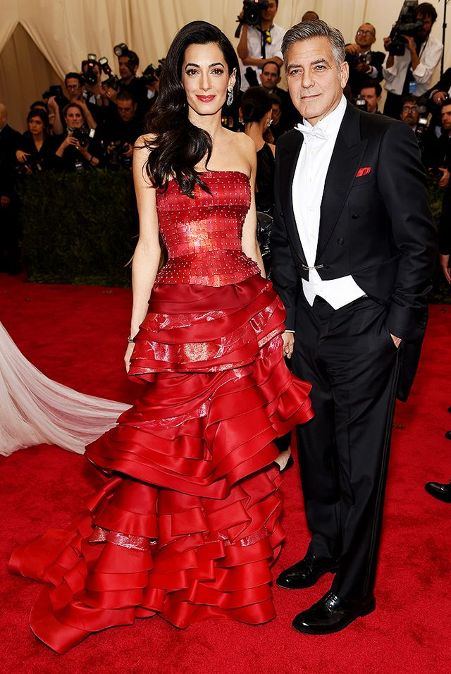 WHO: Amal and George Clooney WEAR: John Galliano for Maison Margiela gown.