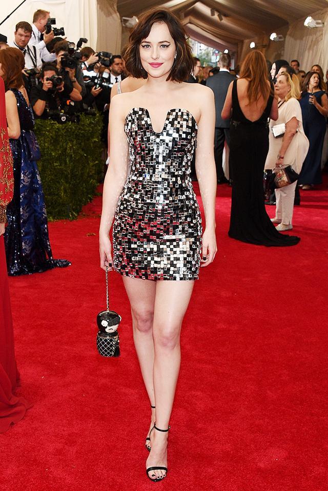 WHO: Dakota Johnson WEAR: Chanel dress.