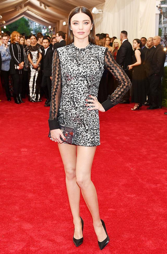 WHO: Miranda Kerr WEAR: Louis Vuitton custom dress and clutch; Lorraine Schwartz jewelry; Giuseppe Zanotti heels.