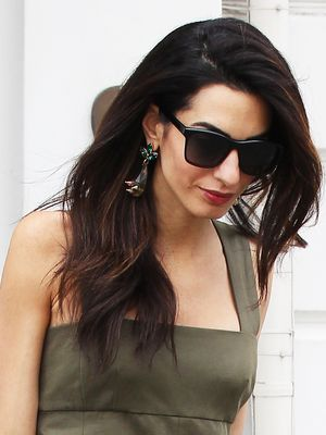 Only Amal Clooney Could Pull Off Overalls Without a Shirt