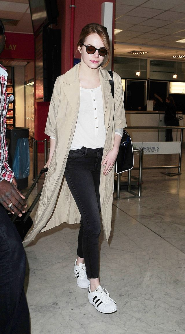 On Emma Stone: J Brand Henley T-Shirt ($95); COS Oversized Poplin Jacket ($175); Adidas Originals Superstar Sneakers ($80); Oliver Peoples L.A. Coen Sunglasses ($365).