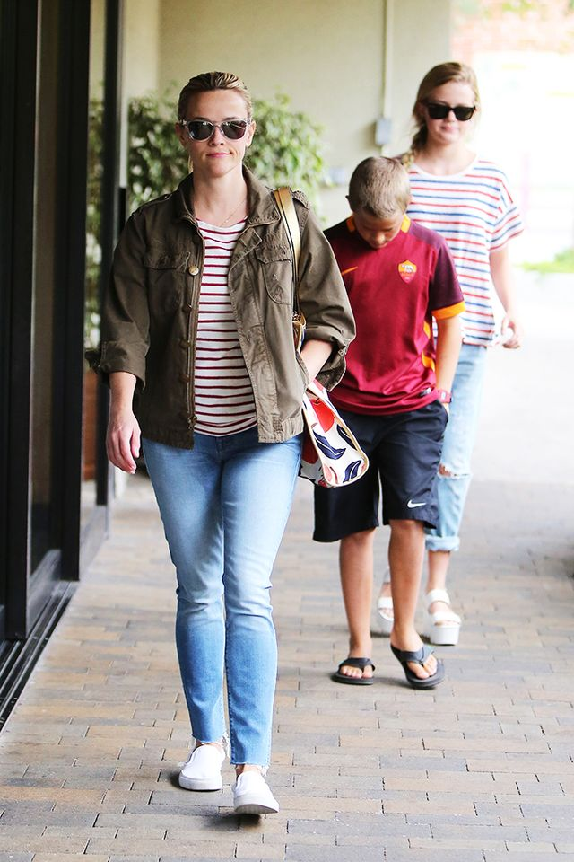 On Reese Witherspoon: Mother The Looker Ankle Fray Jeans ($196) in Tourist Trap; Vans Classic Slip On ($86) in True White; Current/Elliott jacket.