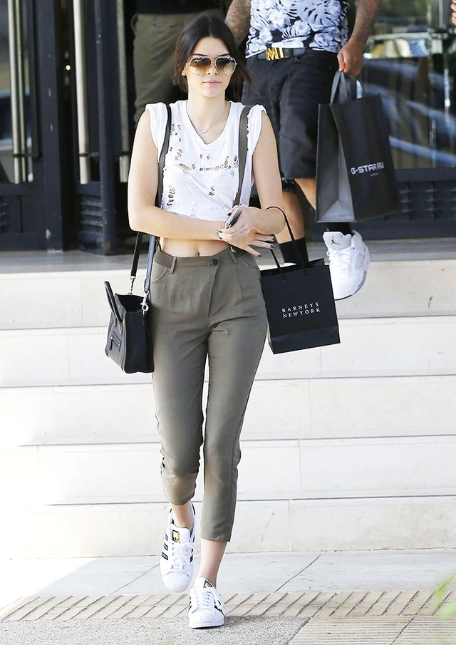 On Kendall Jenner: Adidas Originals Superstar Sneakers ($80); Dita Talon Sunglasses in Satin ($450); Céline handbag.