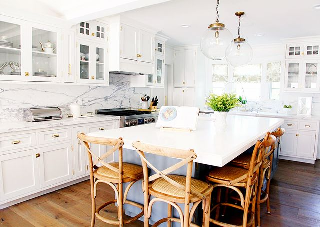 "In the kitchen, a previously ""blah"" design was transformed into an open and inviting space for the family to congregate. ""The kitchen is the heart of the home, and I love the way..."