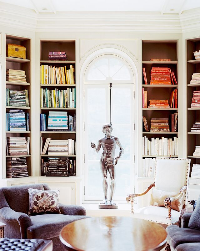 """When styling art and coffee-table books in bookshelves, I arrange them by color for maximum impact."" — Eddie Lee, Eddie Lee Inc."