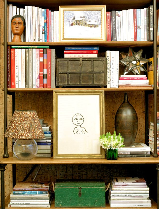 """I like my bookcases very dense, with almost no space between shelf and books, which is why I tend to arrange by size rather than by category. Dewey decimal system be damned! The other trick..."