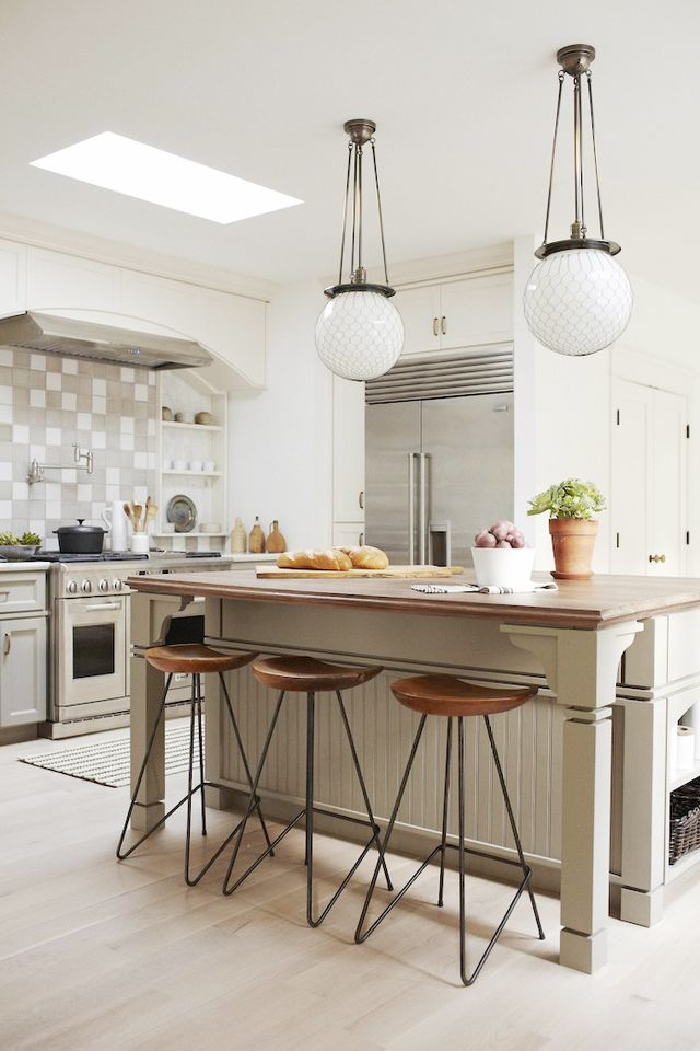 A traditional kitchen design is anchored around a casual island, perfect for gathering around.