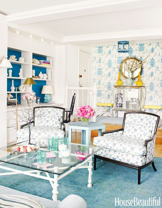 A mix of sweet prints and bold colors enlivens this small Manhattan home's living room. Layered blue tones give the space a real sense of depth while white ceramics and coral specimens...