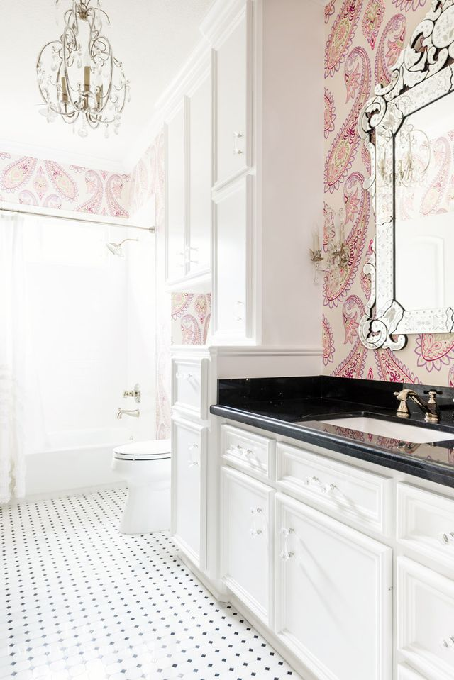 In this classic bathroom, large-scale patterned wallpaper works beautifully with crystal light fixtures to create a luxurious retreat. As with all design, the appeal of the preppy look is in the...