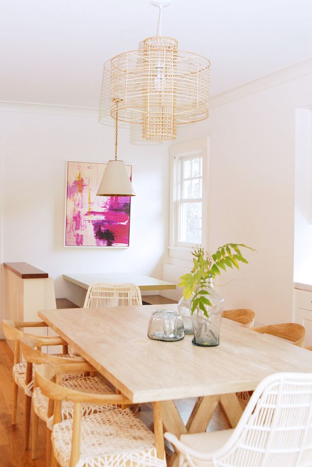 This dining room is a vision of dreamy airiness thanks to a light wood palette accented by tonal, woven details. A pop of fuchsia adds a touch of upbeat verve to the space.