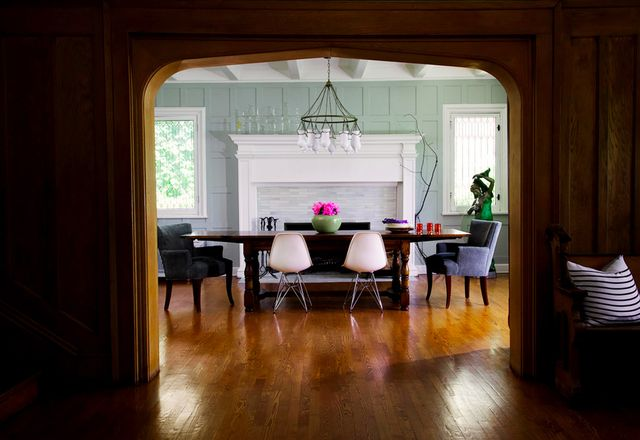 """The sunny dining room is a favorite spot for the family. """"My husband and I fight over the chair in the corner to read the newspaper in,"""" Morton laughs. """"The long antique wood..."""