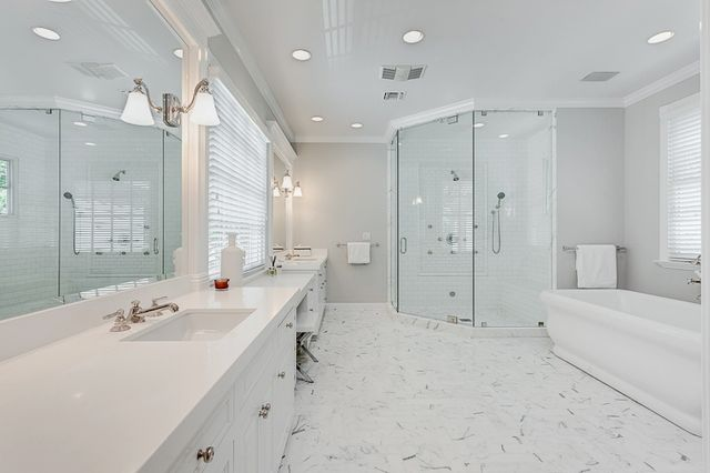 The master suite boasts a soaking tub, steam shower, and giant walk-in closet.